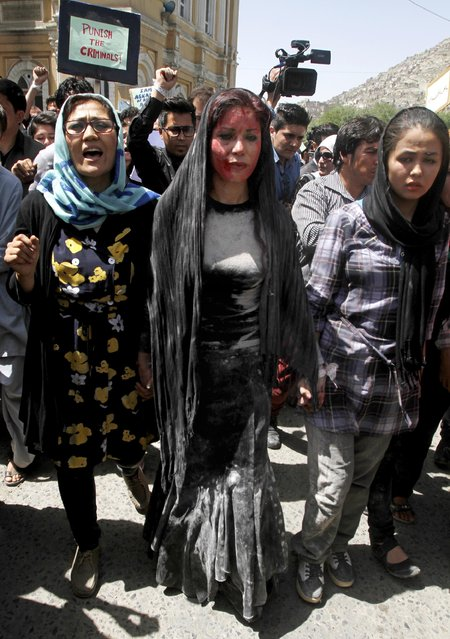 Afghan women chant slogans during a protest demanding justice for a woman who was beaten to death by a mob after being falsely accused of burning a Quran more than one month ago, in downtown Kabul, Afghanistan, Monday, April 27, 2015. (Photo by Allauddin Khan/AP Photo)