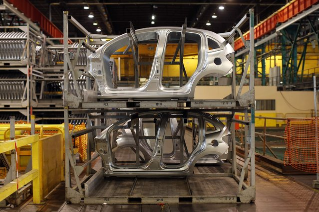 Pressed side pieces of Citroen C3 cars are pictured on the automobile assembly line at the PSA Peugeot Citroen plant in Poissy, near Paris, France, April 29, 2015. (Photo by Benoit Tessier/Reuters)