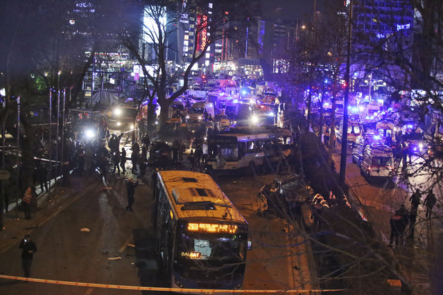 Members of emergency services work at the scene of an explosion in Ankara, Turkey, Sunday, March 13, 2016. (Photo by AP Photo)