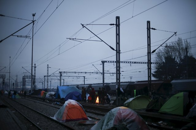 Tents are set next to railway tracks at a makeshift camp for refugees and migrants at the Greek-Macedonian border, near the village of Idomeni, Greece March 15, 2016. (Photo by Alkis Konstantinidis/Reuters)