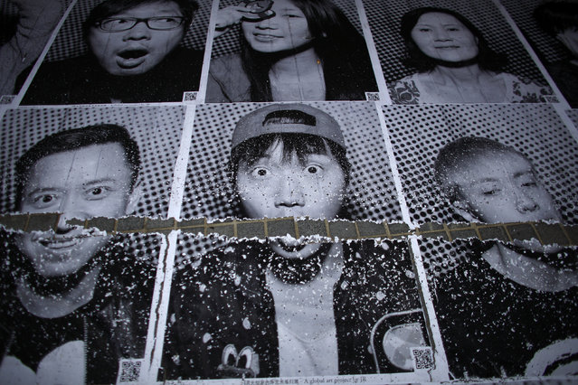 Portraits of people are seen at Xintiandi area in downtown Shanghai, China May 14, 2014. (Photo by Carlos Barria/Reuters)