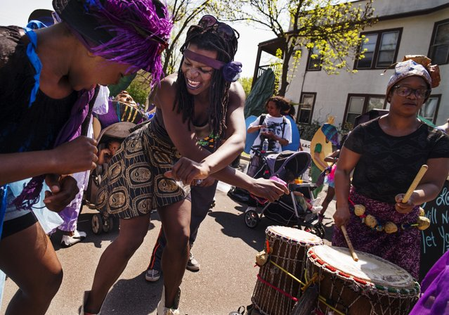 "At the May Day Parade on May 3, 2015 along Bloomington Ave, Minneapolis, Crystal Badiot, left, and Felicia Perry of ""Black is Sacred"" practiced their moves before the official start. (Photo by Richard Tsong-Taatarii/The Star Tribune)"