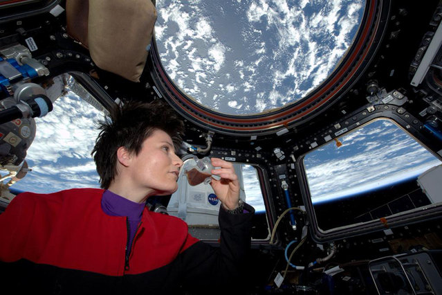 In this photo posted on Twitter, Sunday, May 3, 2015, and provided by NASA, Italian astronaut Samantha Cristoforetti sips espresso from a cup designed for use in zero-gravity, on the International Space Station. Cristoforetti, the first Italian woman in space, fired up the first espresso machine in space, which uses small capsules, or pods, of espresso coffee. (Photo by AP Photo/NASA)