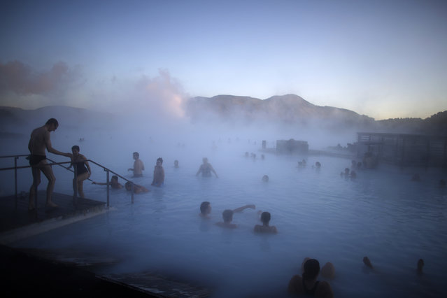 3. ICELAND: People relax in one of the Blue Lagoon hot springs near the town of Grindavik February 14, 2013. (Photo by Stoyan Nenov/Reuters)