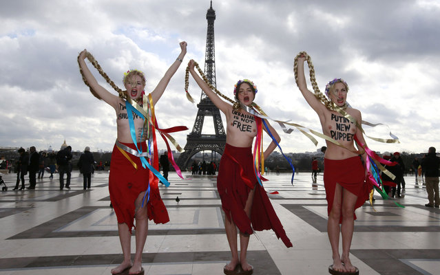 Topless activists from the Ukrainian feminist group Femen stage a protest against Ukrainian opposition leader Yulia Tymoshenko in Paris, on February 25, 2014. (Photo by Gonzalo Fuentes/Reuters)