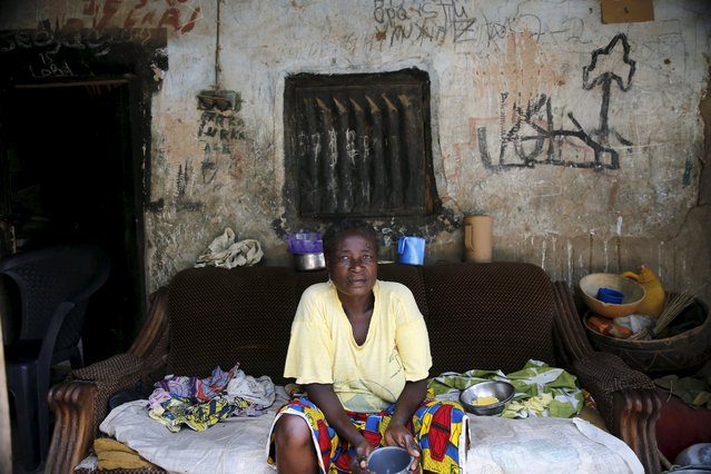 A woman sits in front of her home, once occupied by Boko Haram in Michika town, after the Nigerian military recaptured it from Boko Haram, in Adamawa state May 10, 2015. (Photo by Akintunde Akinleye/Reuters)