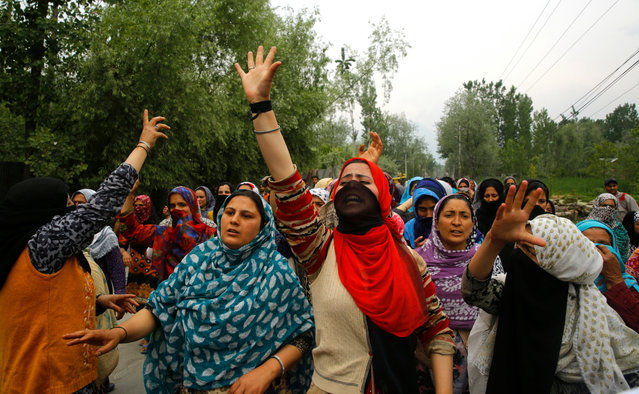 Female Kashmiri Muslim protester shouts slogans during a protest on the outskirts of Srinagar, the summer capital of Indian Kashmir, 13 May 2019. Protests erupted at several places on the second consecutive day in Indian Kashmir against the alleged rape of a three-year-old girl by a local boy at Malikpora, Trehgam area of Sumbal in north Kashmir's Bandiporoa district on 08 May 2019. The protesters were demanding exemplary punishment to the accused who was been arrested by police. (Photo by Farooq Khan/EPA/EFE)