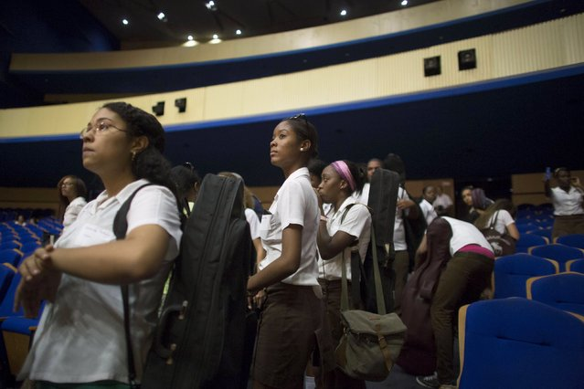 Music students listen to instructions during a rehearsal with the Minnesota Orchestra in Havana, May 15, 2015. (Photo by Alexandre Meneghini/Reuters)