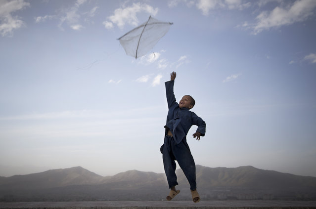 An Afghan boy flies his kite on a hill overlooking Kabul, Afghanistan, May 13, 2013. (Photo by Anja Niedringhaus/AP Photo)