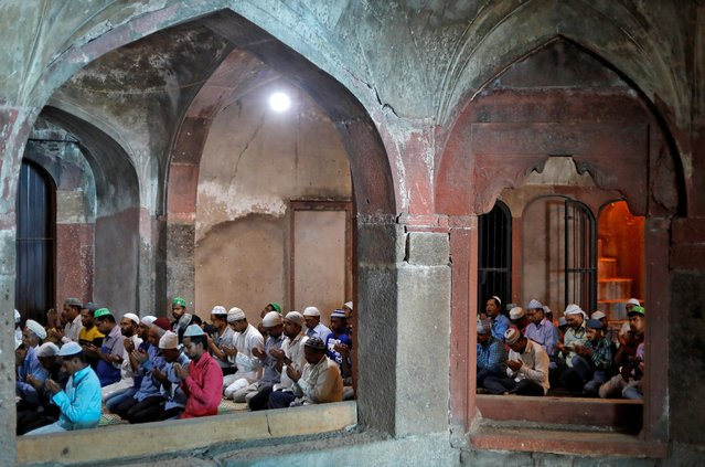 Muslims offer prayers during Jumat-ul-Vida or the last Friday of the holy fasting month of Ramadan at a mosque inside Safdarjung Tomb in New Delhi, India, May 31, 2019. (Photo by Anushree Fadnavis/Reuters)