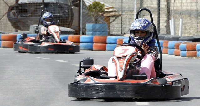 An Iranian girls drive carts at the Frassa carting track in Oshan, northern Iran, 27 March 2014. Following the presidency of Hassan Rowhani and the increase of social liberties young people, also girls have more entertainment facilities. (Photo by Abedin Taherkenareh/EPA)