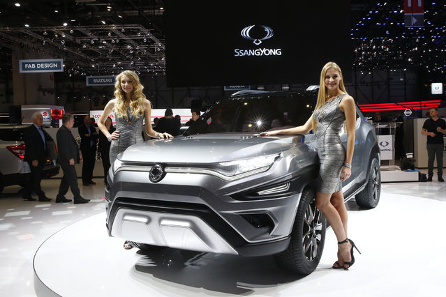 Models pose next to the Ssangyong XAVL Concept car is seen during the 87th International Motor Show at Palexpo in Geneva, Switzerland March 7, 2017. (Photo by Arnd Wiegmann/Reuters)