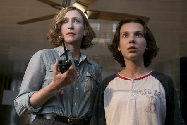 "This image released by Warner Bros. Pictures shows Vera Farmiga, left, and Millie Bobby Brown in a scene from ""Godzilla: King of the Monsters"". (Photo by Daniel McFadden/Warner Bros. Pictures via AP Photo)"