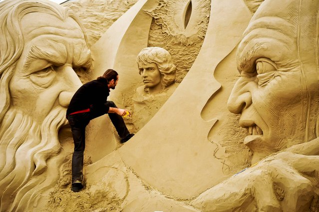 Sculpture Radovan Zivny puts the finishing touches to a huge Lord of the Rings sand sculpture at Sandworld in Weymouth, where the seaside attraction will be open for the British summer season to the general public on Saturday April 5th 2014. (Photo by Ben Birchall/PA Wire)