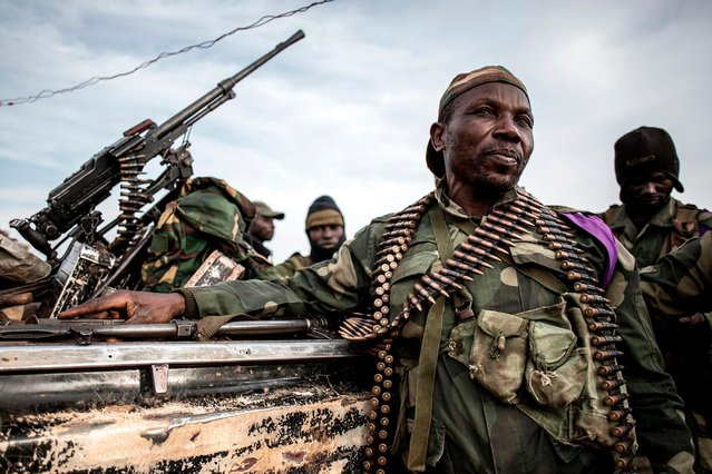 Soldiers of the Armed Forces of the Democratic Republic of the Congo (FARDC) sit in a truck bed in a base on July 3, 2019 in Djugu, eastern DR Congo. (Photo by John Wessels/AFP Photo)