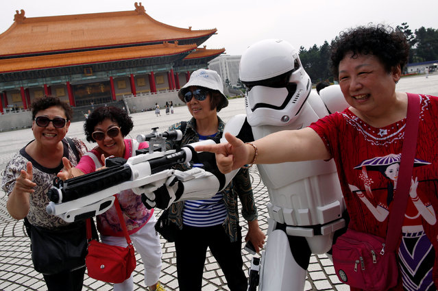 Tourists from China pose with a man dressed as a Storm Trooper from Star Wars during Star Wars Day in Taipei, Taiwan May 4, 2016. (Photo by Tyrone Siu/Reuters)
