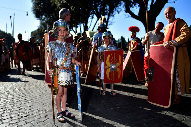 A child dressed as a Roman centurion poses during a parade to mark the anniversary of the foundation of Rome in 753 BC, on April 23, 2017 in Rome. (Photo by Alberto Pizzoli/AFP Photo)