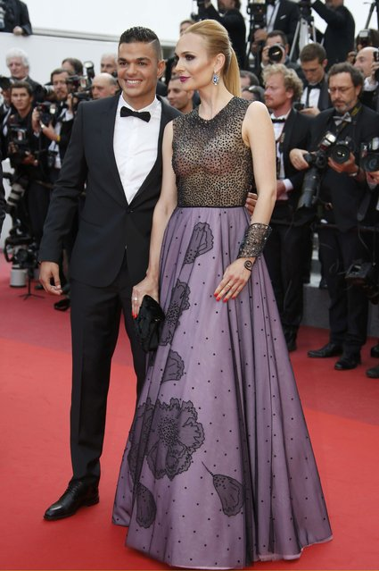 """Soccer player Hatem Ben Arfa (L) poses on the red carpet as he arrives for the screening of film """"Loving"""" in competition at the 69th Cannes Film Festival in Cannes, France, May 16, 2016. (Photo by Eric Gaillard/Reuters)"""