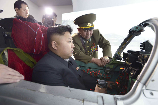 North Korean leader Kim Jong Un inspects the Korean People's Army (KPA) Air and Anti-Air Force Unit 447, which has been honoured with the title of O Jung Hup-led 7th Regiment, in this undated photo released by North Korea's Korean Central News Agency (KCNA) in Pyongyang on May 14, 2014. (Photo by Reuters/KCNA)