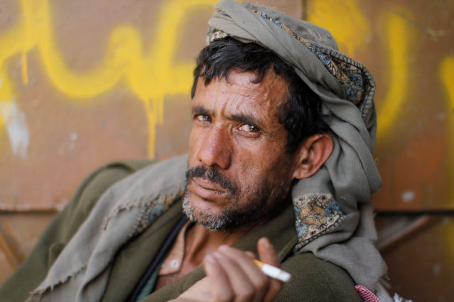 A man smokes as he chews qat, a stimulant, in the old market in the historic city of Sanaa, Yemen, January 22, 2017. (Photo by Mohamed al-Sayaghi/Reuters)