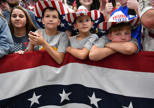 """Supporters of the US president and children wearing """"Trump 2020"""" hats attend a rally at the Monroe Civic Center in Monroe, Louisiana on November 6, 2019. (Photo by Mandel Ngan/AFP Photo)"""