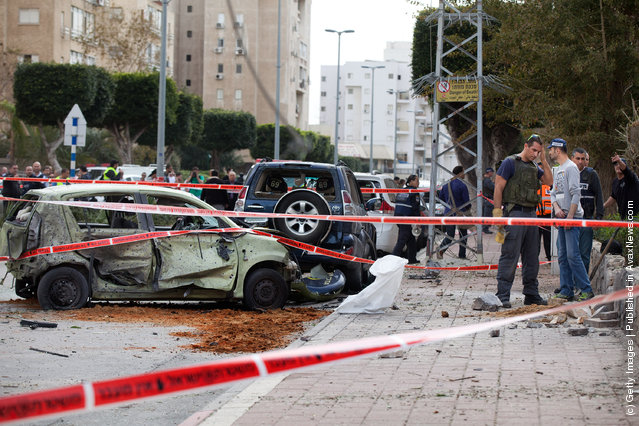 Israeli policemen inspect damage after a rocket attack from the nearby Gaza Strip
