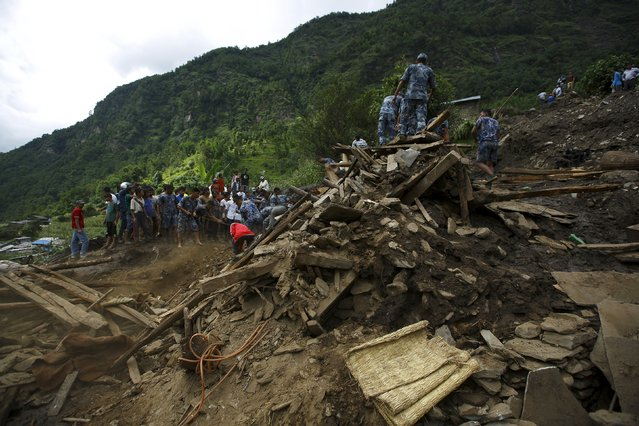 Rescue team members search for the landslide victims at Lumle village in Kaski district July 30, 2015. (Photo by Navesh Chitrakar/Reuters)