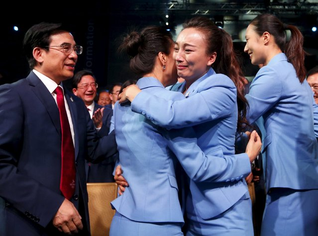 Members of the Beijing delegation hug after Beijing was awarded the 2022 Winter Olympic Games, defeating Almaty in the final round of voting, during the 128th IOC session in Kuala Lumpur, Malaysia July 31, 2015. (Photo by Olivia Harris/Reuters)