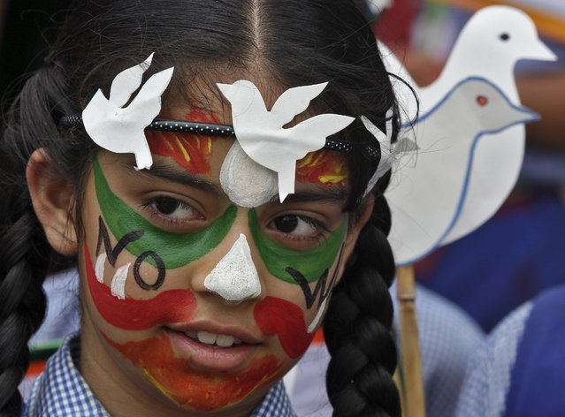 A student participates in a face-painting event to commemorate the 70th anniversary of the atomic bombings of the Japanese cities of Hiroshima and Nagasaki, at a school in Chandigarh, India, August 6, 2015. (Photo by Ajay Verma/Reuters)