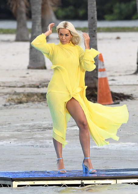 Singer Rita Ora, 29, was caught out by an ocean breeze as she filmed a shoe ad – just like Marilyn was by a subway breeze in her famed flying skirt photo – on Miami Beach, south Florida on January 11, 2020. (Photo by The Mega Agency)