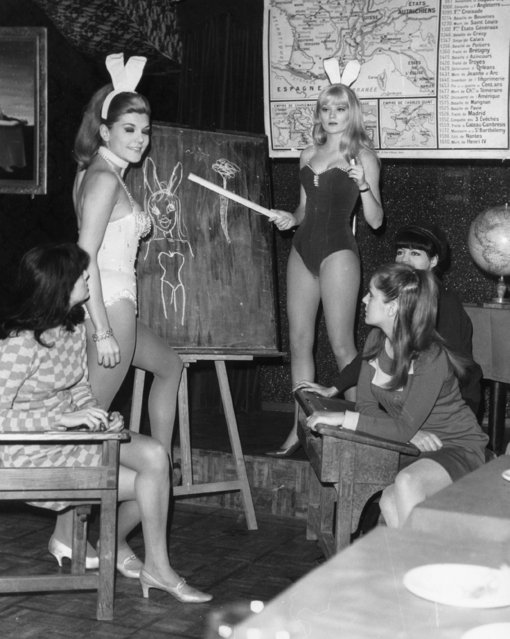 "Prospective ""bunny girl"" hostesses for the ""Black Jack"" club in Paris, France are taught the refinements of the job by Rio Sefarini and Laura Ulmer (daughter of George Ulmer), circa 1965.  (Photo by Keystone/Getty Images)"
