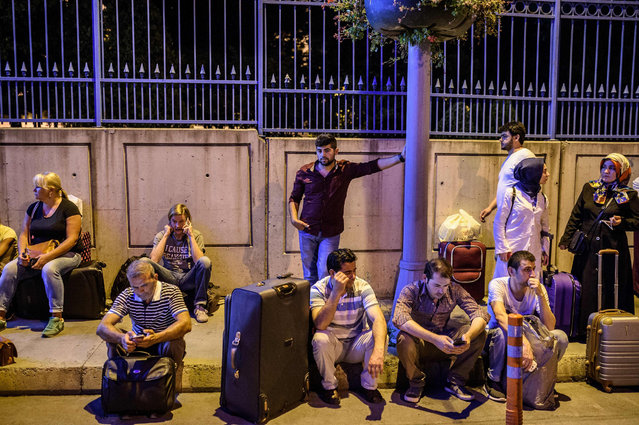Passengers wait with their luggage outside the Ataturk airport in Istanbul, in June 28, 2016, after two explosions followed by gunfire hit the Turkey's biggest airport, killing at least 10 people and injured 20. All flights at Istanbul's Ataturk international airport were suspended on June 28, 2016 after a suicide attack left at least 10 people dead and 20 others wounded, Turkish television stations reported. (Photo by Ozan Kose/AFP Photo)