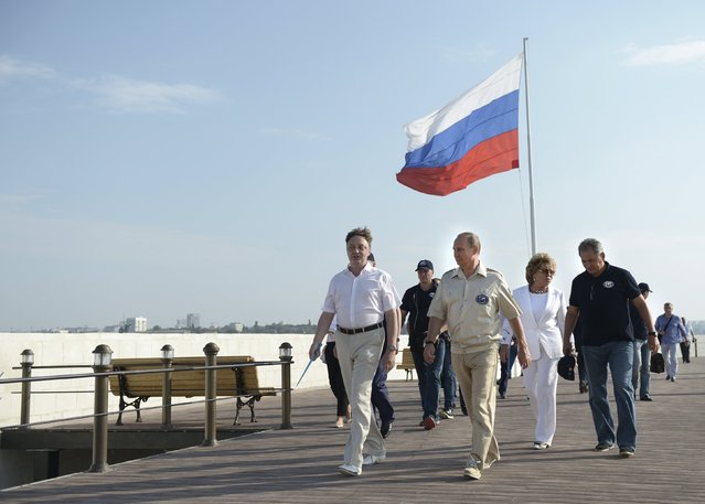 Russian President Vladimir Putin (R, front), accompanied by Federation Council Speaker Valentina Matviyenko (2nd R) and Sergei Shoigu, visits the restored historical Konstantinovskaya casemated battery, a fortified cannon position for guarding the bay, in Sevastopol, Crimea, August 18, 2015. (Photo by Alexei Nikolsky/Reuters/RIA Novosti/Kremlin)