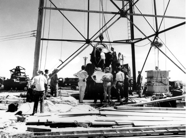 In this July 1945, file photo, scientists and workmen rig the world's first atomic bomb to raise it up into a 100-foot tower at the Trinity bomb test site in the desert near Alamagordo, N.M. (Photo by AP Photo)