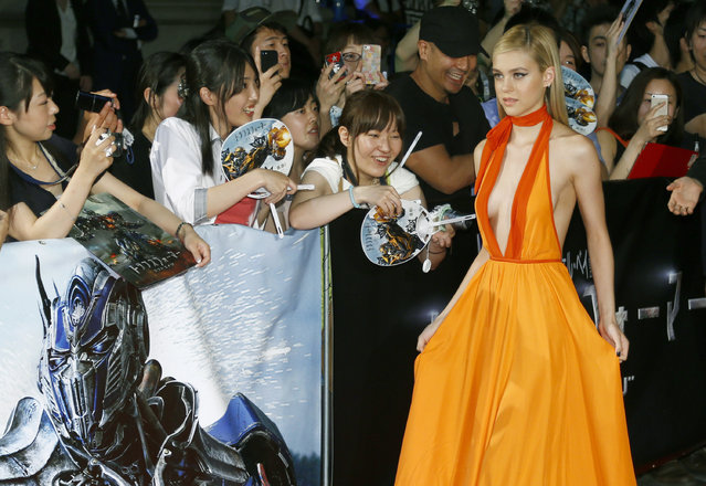 Actress Nicola Peltz poses for photographers during Japan premiere of Transformers: Age of Extinction in Tokyo Monday, July 28, 2014. (Photo by Shizuo Kambayashi/AP Photo)