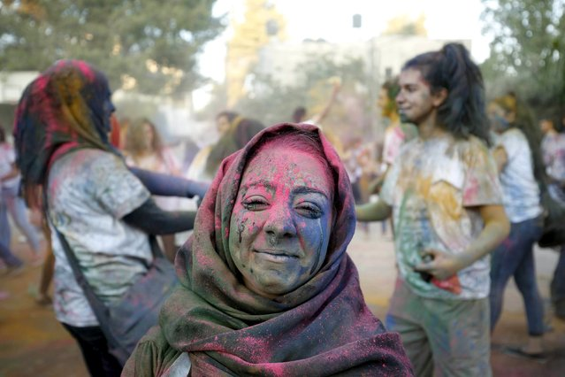 A Palestinian reveller takes part in a colours festival organized by Palestinian activists in the West Bank city of Ramallah August 20, 2015. The festival is inspired by the Hindu spring festival of Holi. (Photo by Mohamad Torokman/Reuters)