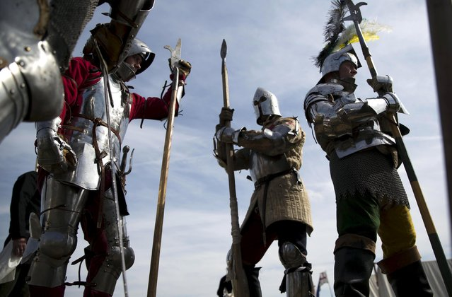 Historical re-enactors in a living history camp prepare their costumes as they take part in an anniversary event for the Battle of Bosworth near Market Bosworth in central Britain August 22, 2015. (Photo by Neil Hall/Reuters)