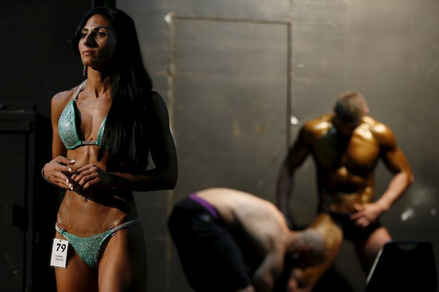 Palestinian Anoush Belian stands backstage during a bodybuilding competition in Tel Aviv, Israel August 22, 2015. Belian, from Jerusalem, on Saturday became the first Palestinian female bodybuilder to participate and win an Israeli competition. Belian won the Miss Fitness category in the competition organised by the National Amateur Bodybuilders Association (NABBA) in Israel. (Photo by Ammar Awad/Reuters)