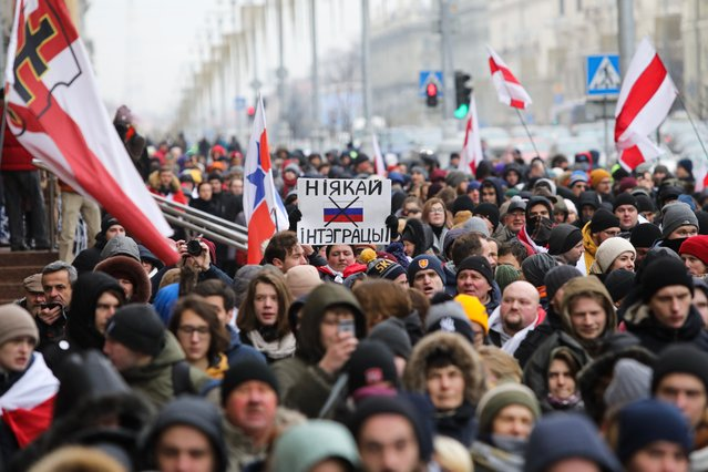 People participate in protests against the integration of Belarus with Russia in Minsk on December 7, 2019. (Photo by Radio Free Europe/Radio Liberty)
