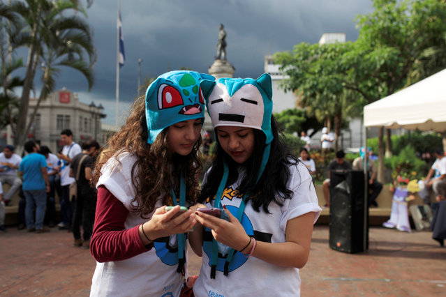 """People play the augmented reality mobile game """"Pokemon Go"""" by Nintendo participate in a """"poketour"""" organized by the municipality in San Salvador, El Salvador July 23, 2016. (Photo by Jose Cabezas/Reuters)"""