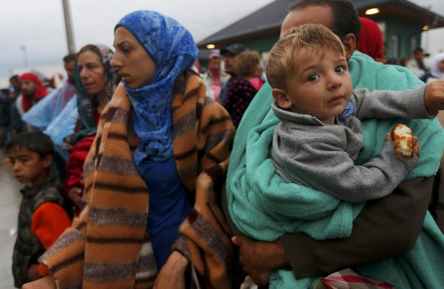 Migrants wait for buses after crossing Austrian border in Nickelsdorf, September 5, 2015. (Photo by Laszlo Balogh/Reuters)