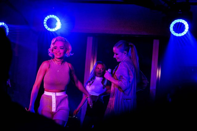 """Rita Ora, left, and Iggy Azalea, right perform """"Black Widow"""" during a party thrown by Calvin Klein for New York Fashion Week, September 8, 2014. (Photo by Amy Lombard/The New York Times)"""