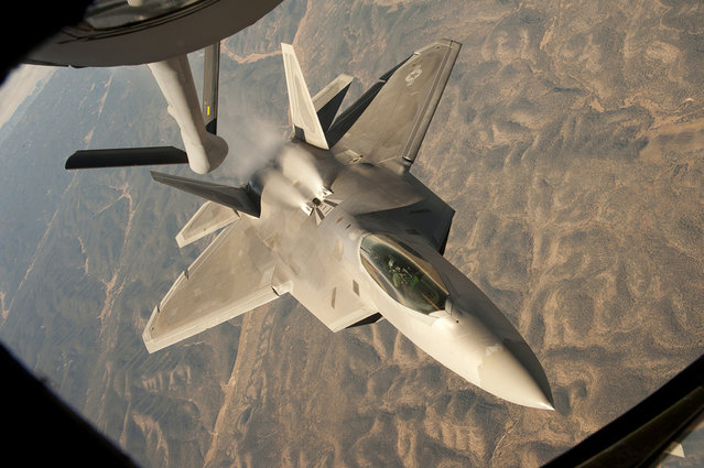 An F-22 Raptor backs away from a KC-135 Stratotanker during a training mission over central New Mexico. The Raptor is assigned to the 49th Fighter Wing at Holloman Air Force Base, NM., and the KC-135 is from McConnell Air Force Base, Kan. (Photo by USAF)