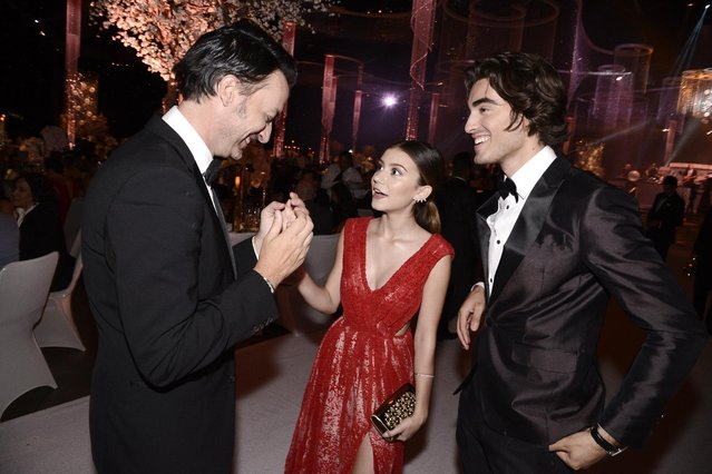 G. Hannelius, center, and Blake Michael attend the Governors Ball for the Television Academy's Creative Arts Emmy Awards at Microsoft Theater on Saturday, September 12, 2015, in Los Angeles. (Photo by Dan Steinberg/Invision for the Television Academy/AP Images)