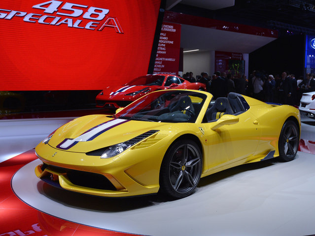 The new Ferrari 458 M is displayed at the 2014 Paris Auto Show on October 2, 2014 in Paris, on the first of the two press days. (Photo by Miguel Medina/AFP Photo)