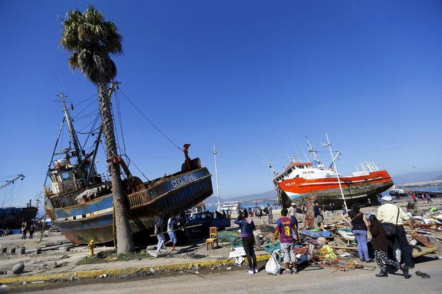Ships are seen on the street after an earthquake hit areas of central Chile, in Coquimbo city, north of Santiago, Chile, September 17, 2015. (Photo by Ivan Alvarado/Reuters)