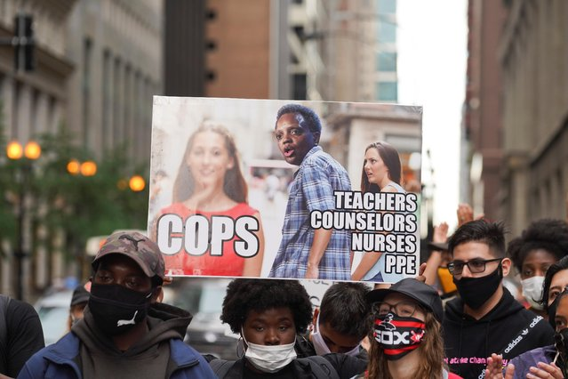 A demonstrator displays a sign at Daley Plaza during a march to demand that police officers be removed from schools in Chicago, Illinois, U.S., June 24, 2020. (Photo by Max Herman/Reuters)