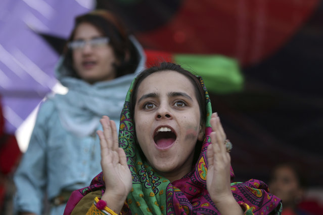 In this September 22, 2017 file photo, cricket fans celebrate during the Shpageeza Cricket League (SCL) final match in Kabul, Afghanistan. The annual survey by the San Francisco-based Asia Foundation, released Tuesday, November 14, 2017, has found that Afghans are slightly more optimistic about the future than they were last year, despite a stagnant economy and near-constant attacks by a revitalized Taliban. (Photo by Rahmat Gul/AP Photos)