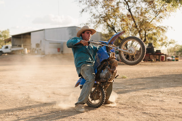 17-year-old station ringer Kody Taylor puts the station manager's son's bike through its paces in far north Queensland, Australia. Kody hoped to be a champion bull rider and boxer until an injury cut his sporting career short. (Photo by Benjamin Rutherford)