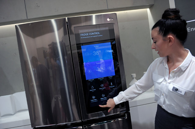 An assistant presents a smart home refridgerator by LG at the IFA Electronics show in Berlin, Germany September 2, 2016. (Photo by Stefanie Loos/Reuters)